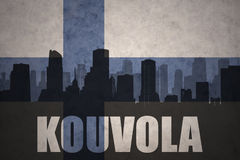 Abstract silhouette of the city with text Kouvola at the vintage finnish flag. Background Royalty Free Stock Images