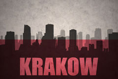 Abstract silhouette of the city with text Krakow at the vintage polish flag Stock Photo