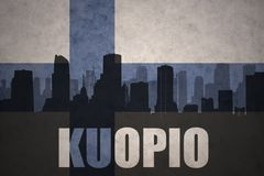 Abstract silhouette of the city with text Kuopio at the vintage finnish flag. Background Royalty Free Stock Photography