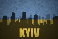 Abstract silhouette of the city with text Kyiv at the vintage ukrainian flag Royalty Free Stock Image