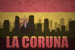 Abstract silhouette of the city with text La Coruna at the vintage spanish flag. Background Stock Photography