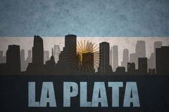 Abstract silhouette of the city with text La Plata at the vintage argentinean flag Stock Photos