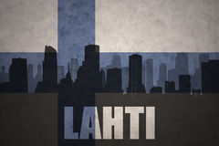 Abstract silhouette of the city with text Lahti at the vintage finnish flag. Background Royalty Free Stock Photo