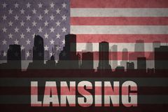 Abstract silhouette of the city with text Lansing at the vintage american flag Royalty Free Stock Photos