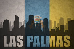 Abstract silhouette of the city with text Las Palmas at the vintage canary islands flag Royalty Free Stock Photo