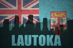 Abstract silhouette of the city with text Lautoka at the vintage Fiji flag Stock Image