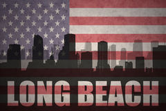 Abstract silhouette of the city with text Long Beach at the vintage american flag. Background Royalty Free Stock Photos
