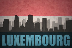 Abstract silhouette of the city with text luxembourg at the vintage luxembourg flag Royalty Free Stock Images