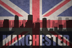 Abstract silhouette of the city with text Manchester at the vintage british flag Royalty Free Stock Photo