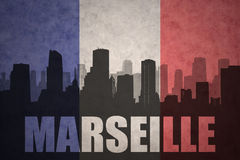 Abstract silhouette of the city with text Marseille at the vintage french flag. Background Royalty Free Stock Photography