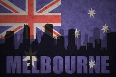 Abstract silhouette of the city with text Melbourne at the vintage australian flag Stock Image