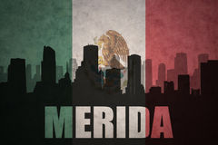 Abstract silhouette of the city with text Merida at the vintage mexican flag. Background Stock Images