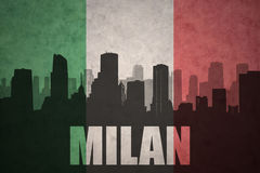 Abstract silhouette of the city with text Milan at the vintage italian flag Stock Images