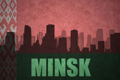 Abstract silhouette of the city with text Minsk at the vintage belarus flag Stock Images