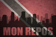 Abstract silhouette of the city with text Mon Repos at the vintage trinidad and tobago flag Stock Photography