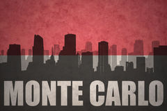 Abstract silhouette of the city with text monte carlo at the vintage monaco flag. Background vector illustration