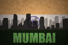 Abstract silhouette of the city with text Mumbai at the vintage indian flag. Background Royalty Free Stock Photography