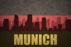 Abstract silhouette of the city with text Munich at the vintage german flag. Background Royalty Free Stock Photos