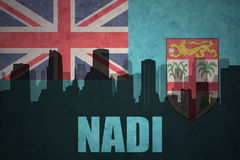 Abstract silhouette of the city with text Nadi at the vintage Fiji flag Royalty Free Stock Photos