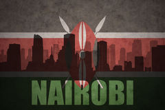 Abstract silhouette of the city with text Nairobi at the vintage kenyan flag Stock Image