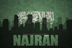 Abstract silhouette of the city with text Najran at the vintage saudi arabia flag Stock Photo