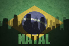 Abstract silhouette of the city with text Natal at the vintage brazilian flag. Background Stock Photography