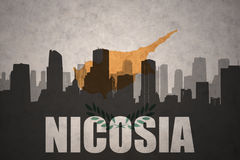 Abstract silhouette of the city with text Nicosia at the vintage cyprus flag Royalty Free Stock Photography