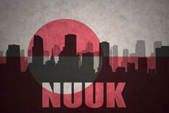 Abstract silhouette of the city with text Nuuk at the vintage greenland flag Stock Photo
