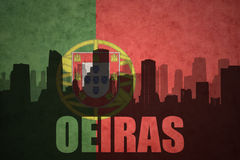 Abstract silhouette of the city with text Oeiras at the vintage portuguese flag Royalty Free Stock Images