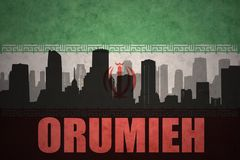 Abstract silhouette of the city with text Orumieh at the vintage iranian flag. Background Royalty Free Stock Image