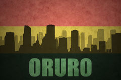 Abstract silhouette of the city with text Oruro at the vintage bolivian flag Royalty Free Stock Photography