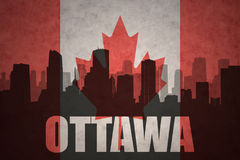 Abstract silhouette of the city with text Ottawa at the vintage canadian flag Royalty Free Stock Photography