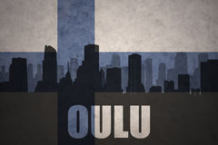 Abstract silhouette of the city with text Oulu at the vintage finnish flag. Background Royalty Free Stock Photo