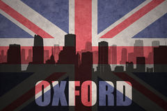 Abstract silhouette of the city with text Oxford at the vintage british flag Royalty Free Stock Photography