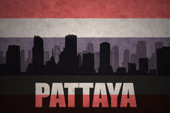 Abstract silhouette of the city with text Pattaya at the vintage thailand flag royalty free illustration