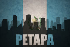 Abstract silhouette of the city with text Petapa at the vintage guatemalan flag Royalty Free Stock Photo