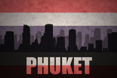 abstract silhouette of the city with text Phuket at the vintage thailand flag royalty free illustration