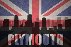 Abstract silhouette of the city with text Plymouth at the vintage british flag Royalty Free Stock Image