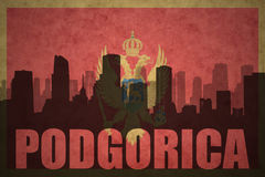 Abstract silhouette of the city with text Podgorica at the vintage montenegro flag Stock Images