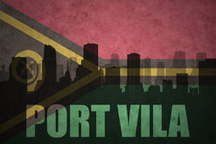 Abstract silhouette of the city with text Port Vila at the vintage Vanuatu flag Royalty Free Stock Photos