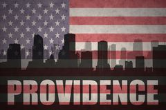 Abstract silhouette of the city with text Providence at the vintage american flag Royalty Free Stock Photography
