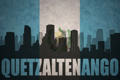 Abstract silhouette of the city with text Quetzaltenango at the vintage guatemalan flag Stock Photos