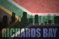 Abstract silhouette of the city with text Richards Bay at the vintage south africa flag Stock Images