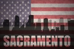 Abstract silhouette of the city with text Sacramento at the vintage american flag Royalty Free Stock Photography