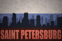 Abstract silhouette of the city with text Saint Petersburg at the vintage russian flag Stock Images