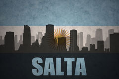 Abstract silhouette of the city with text Salta at the vintage argentinean flag. Background Stock Photography