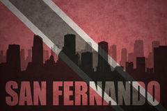 Abstract silhouette of the city with text San Fernando at the vintage trinidad and tobago flag Stock Photos