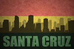 Abstract silhouette of the city with text Santa Cruz at the vintage bolivian flag Stock Photo