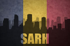Abstract silhouette of the city with text Sarh at the vintage chad flag Royalty Free Stock Image