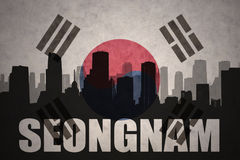 Abstract silhouette of the city with text Seongnam at the vintage south korea flag. Background stock photography